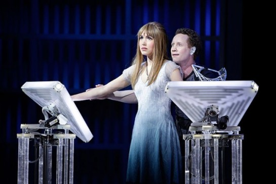 Sara Heaton as Miranda and Hal Cazalet ('96, voice/opera) as Nicholas—and robots—are seen in a 2011 Chicago Opera Theater performance of Tod Machover's Death and the Powers. It will be presented by the Dallas Opera this month.  (Photo by Jonathan Williams)