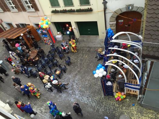 The scene outside my hotel - just arrived - in Lucerne, with zoot-suited sax and brass players serenading a motley crew. There's apparently a big blast-off at 2 pm, so I am going to try to find that now.