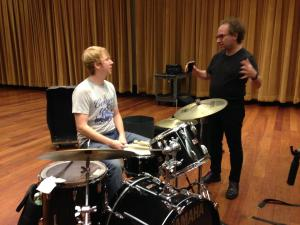 Composer Tod Machover works with a Detroit Symphony Orchestra percussionist on what the beat of Detroit sounds like. CREDIT EMILY FOX / MICHIGAN RADIO