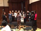 Members of the Chaldean Choir testing out their onstage position in Detroit's Orchestra Hall.