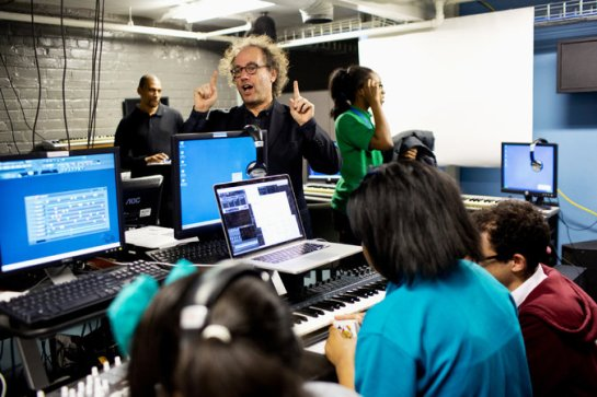 "The composer Tod Machover with students at YouthVille in Detroit. They will take part in his ""Symphony in D,"" a ""city symphony"" that will have its premiere with the Detroit Symphony Orchestra. Credit Laura McDermott for The New York Times"